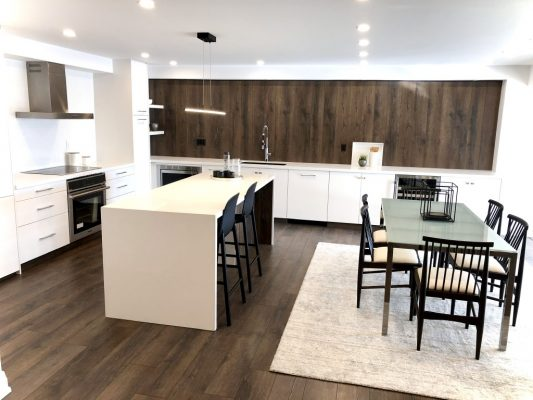 Image depicts a kitchen with newly painted white walls.
