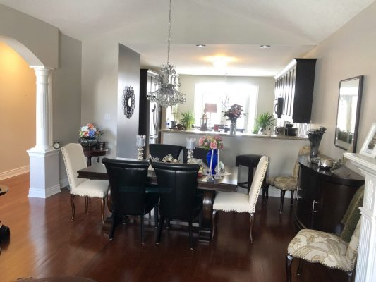 Image depicts a home's kitchen with newly painted white walls.
