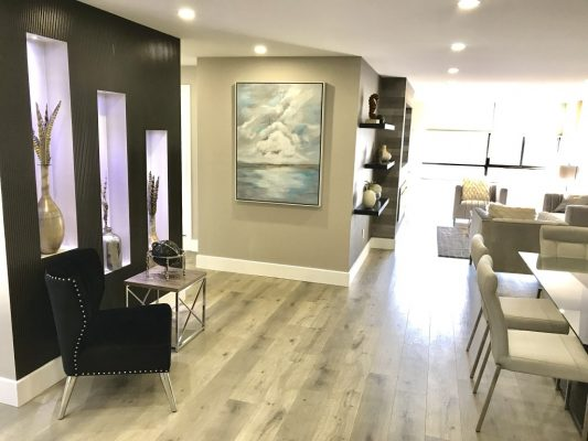 Interior of home with walls painted light grey and black.