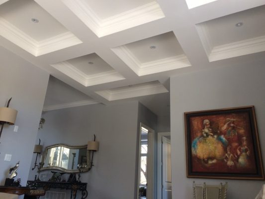 Image depicts a recently painted white waffle ceiling.