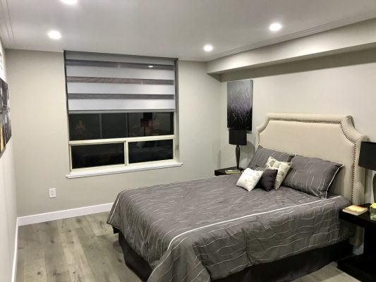 Image depicts a bedroom that has been recently painted by Arkadys Painting.