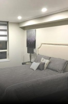 Image depicts a bedroom with walls and baseboard painted by Arkadys Painting.